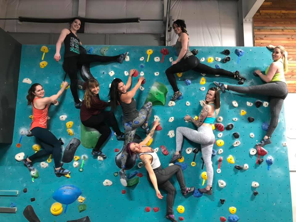 Aradia Fitness Calgary Instructors all on a bouldering wall at Bolder Climbing Community