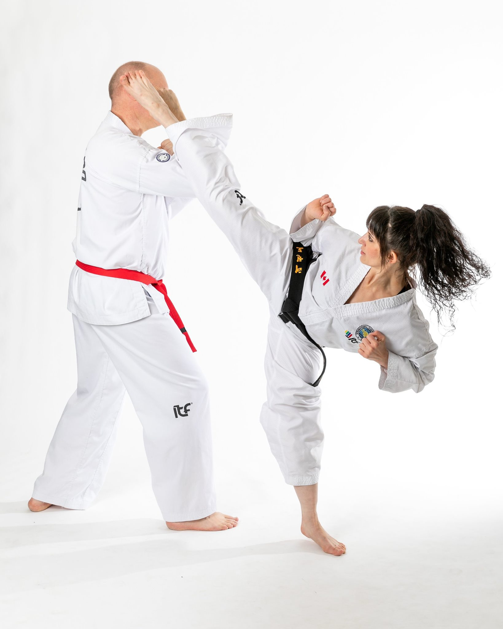 Aradia Fitness Calgary featured instructor Tatiana Vladimirovna demonstrating a Taekwan-do high kick