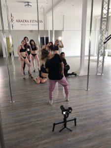 Kira Noire helping to pose the instructors of Aradia Fitness Calgary for their feature video shoot.