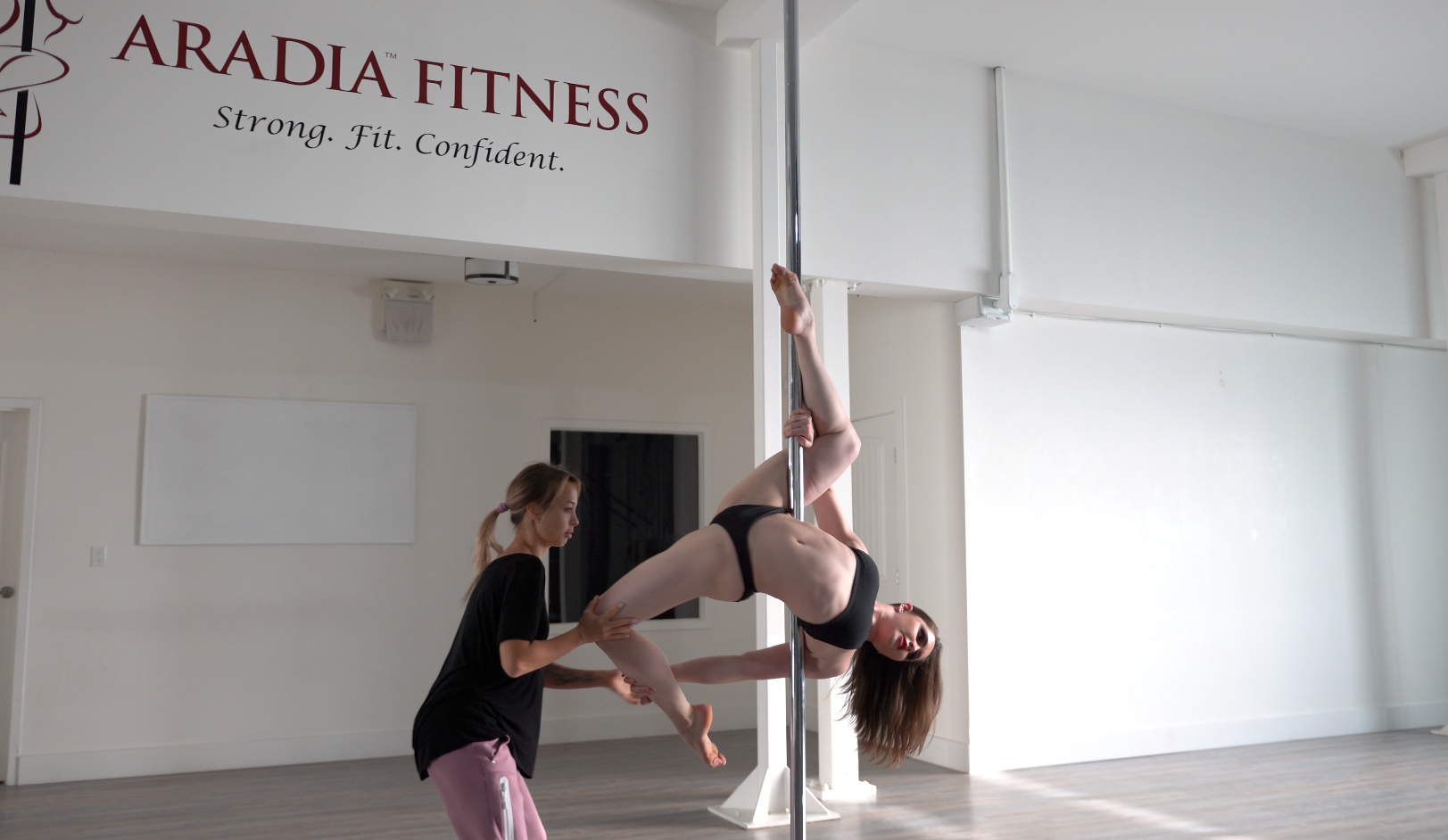 Kira Noire assisting Clare Burton during the Aradia Fitness Calgary Feature Video Shoot