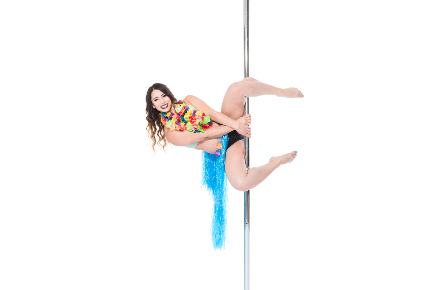 Aradia Fitness Calgary instructor Amanda Myers in a genie pose on pole