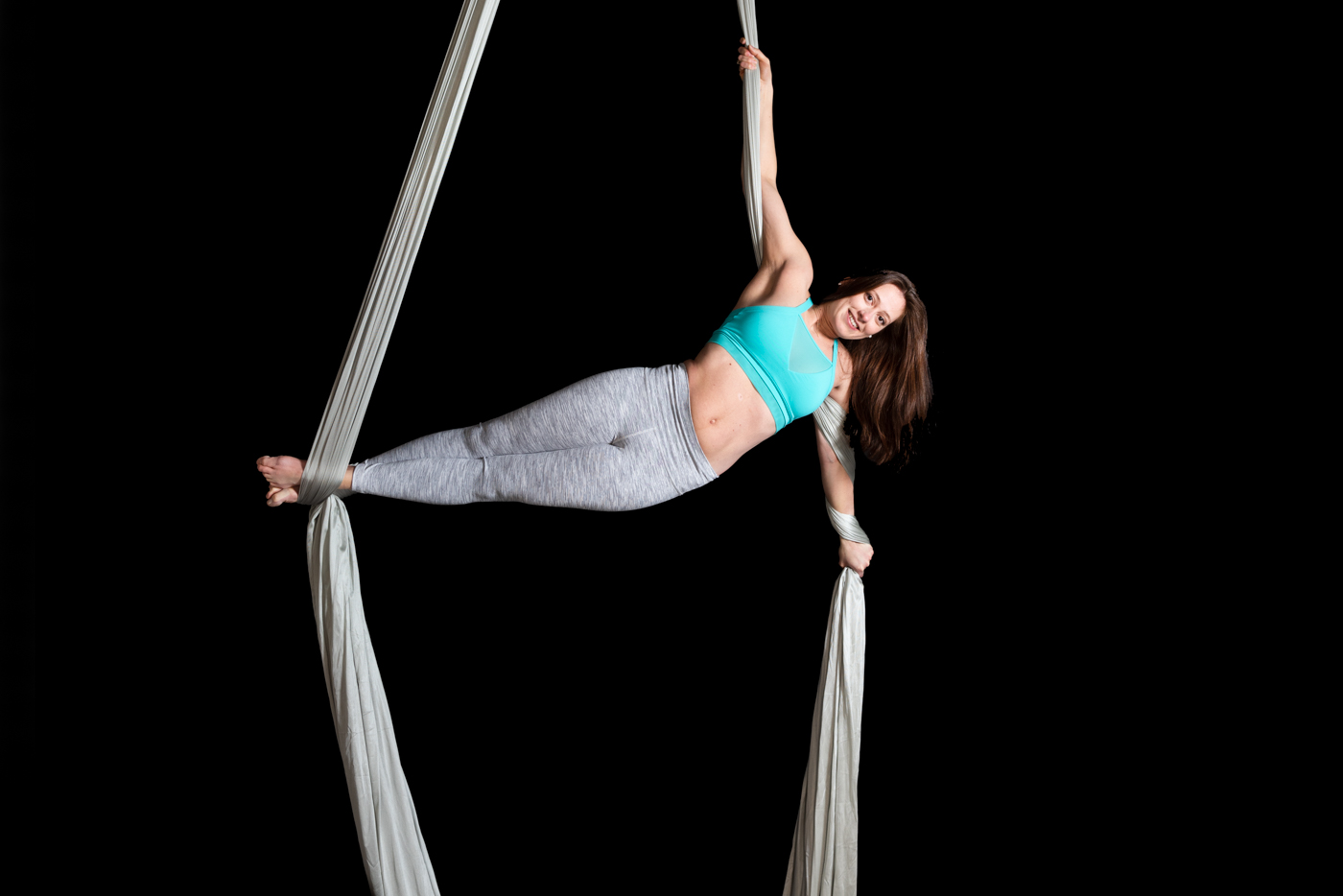 Aradia Fitness Instructor Cassia Farias on aerial silks