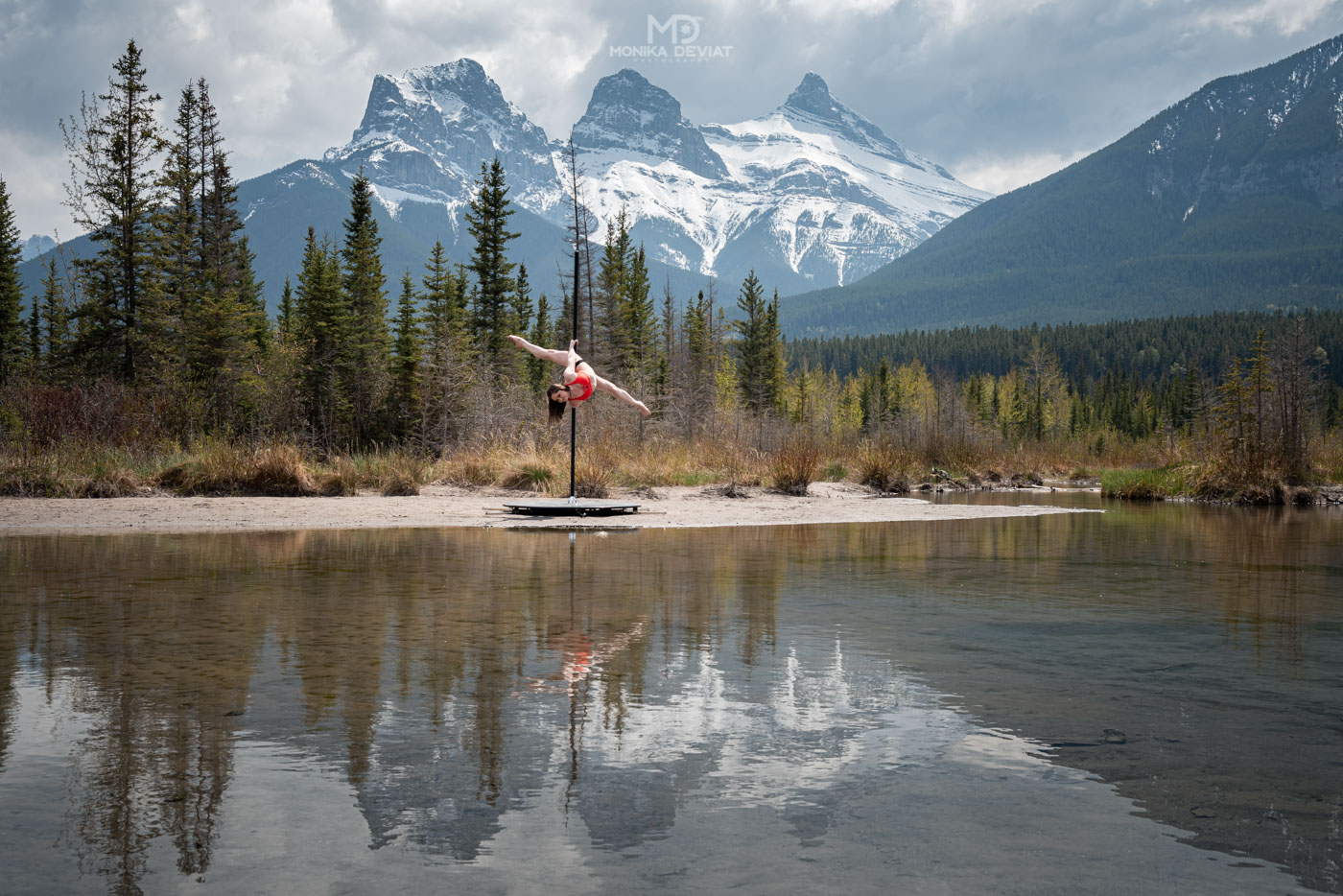 Aradia Fitness Calgary feature instructor Clare Burton pole dancing in the Canadian Rockies