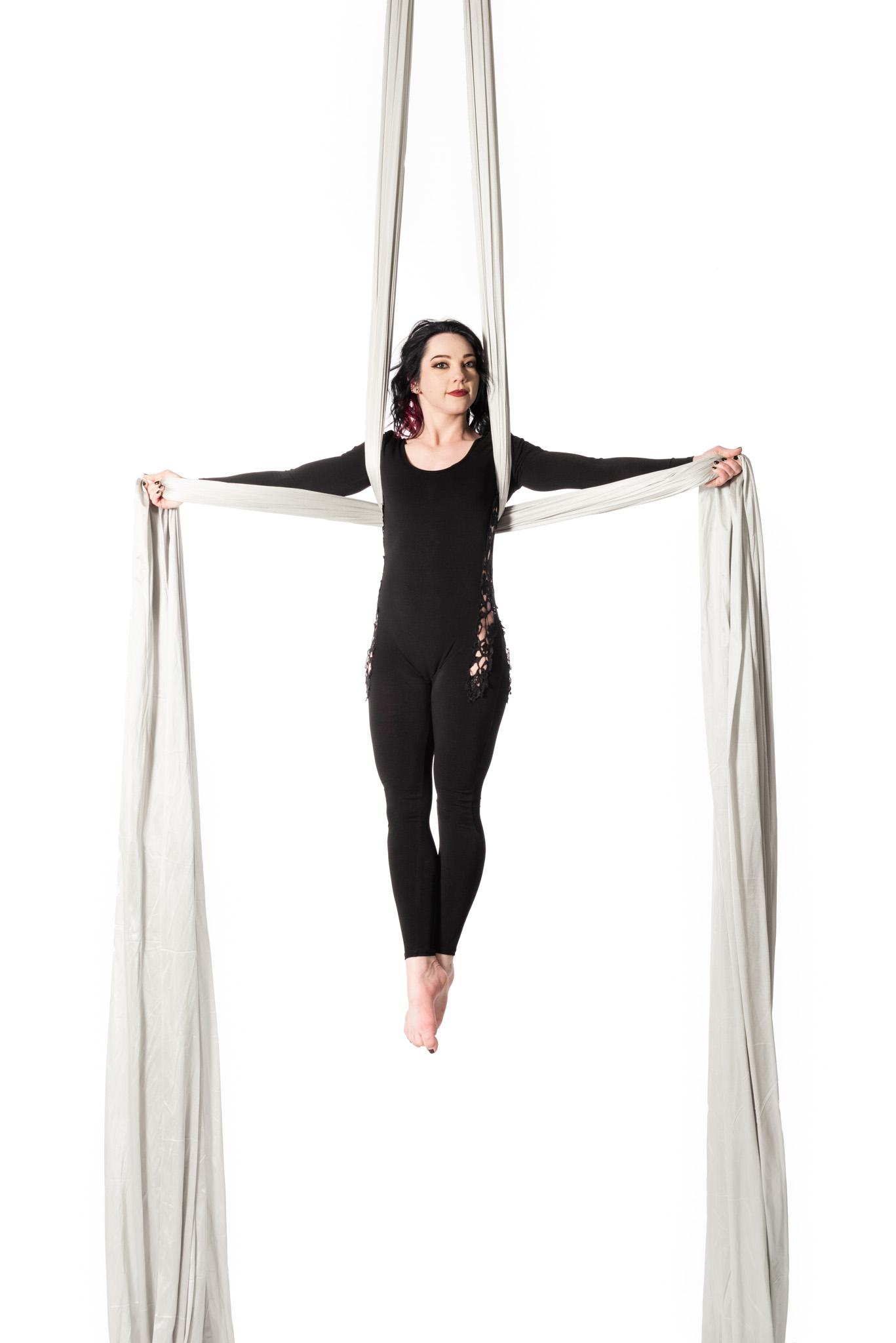 Aradia Fitness Calgary featured Instructor Felicia Salzmann in Iron Cross on silks