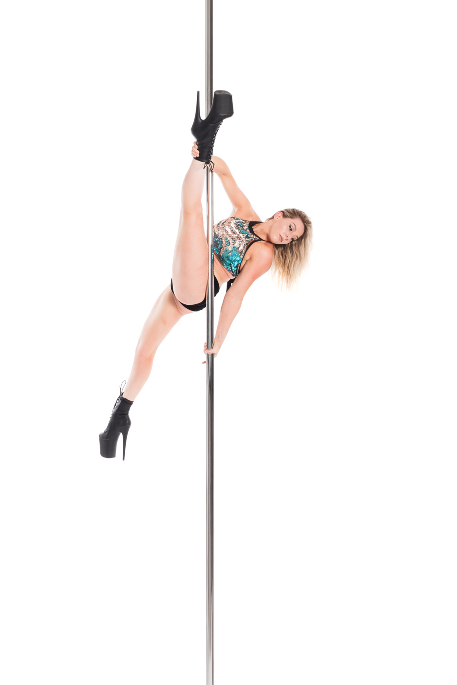 Featured Aradia Fitness Calgary instructor Jordanna in forearm hold split on pole